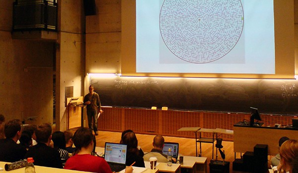 Professor lecturing in large lecture hall
